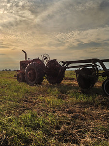 Farmall tractor and hay rake, Jasper County, Indiana.